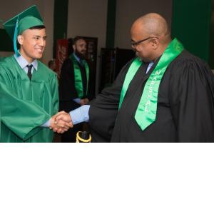 HPS Advising's Terry Williams congratulating a graduate